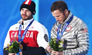 Bode Miller, right, who shared the men's super-G bronze medal position with Canada's Jan Hudec, feels the emotion during the medal ceremony in Sochi on Sunday. Photograph: Srdjan Suki/EPA