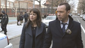 Danny (Donnie Wahlberg and Maria (Marisa Ramirez)  search for answers in 'Open Secrets' on Friday's #1 program on television, 'Blue Bloods'.