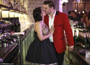 Sealed with a kiss: My Kitchen Rules judge Manu Feildel celebrated the grand opening of his new Melbourne restaurant Le Grand Cirque, with a kiss from his fiance on Wednesday as it topped all programming in Australia.