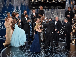 Best Picture 2013 '12 Years A Slave' with (back row) actors Sarah Paulson, Benedict Cumberbatch, Lupita Nyong'o, screenwriter John Ridley, actor Chiwetel Ejiofor, producers Arnon Milchan, Dede Gardner, Jeremy Kleiner and Anthony Katagas, actress Adepero Oduye and producer Brad Pitt onstage during the Oscars at the Dolby Theatre on March 2, 2014 in Hollywood, California.  (Photo by Kevin Winter/Getty Images)