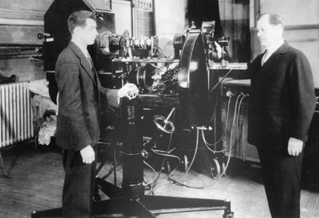 Ernst F.W. Alexander, on the right, presented the first television projection.