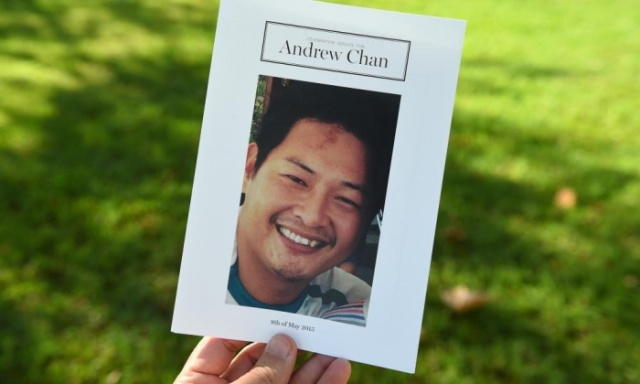 https://au.news.yahoo.com/video/watch/27706851/thousands-farewell-andrew-chan-at-funeral/