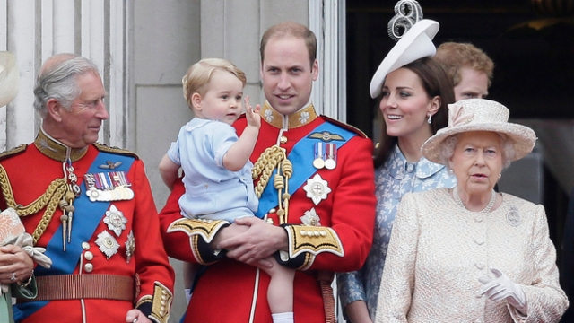 Britain's Prince William holds his son Prince George, with Queen Elizabeth II, right, Kate, Duchess of Cambridge and the Prince of Wales during the Trooping The Colour parade at Buckingham Palace, in London, Saturday, June 13, 2015.  https://au.news.yahoo.com/world/a/28434672/george-steals-queens-birthday-show/?cmp=st