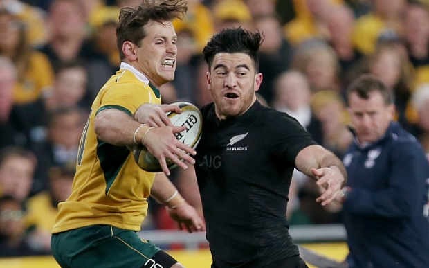 New Zealand's Nehe Milner-Skudder, right, charges Australia's Adam Ashley-Cooper during their Rugby Championship match in Sydney, Australia, Saturday, Aug. 8, 2015.(AP Photo/Rick Rycroft)