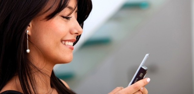 pretty-girl-smiling-profile-looking-at-cell-phone-1024x500